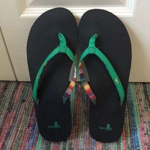 NWOT Sanuk green flip flops